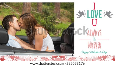Young couple smooching on the backseat against i love you message - stock photo