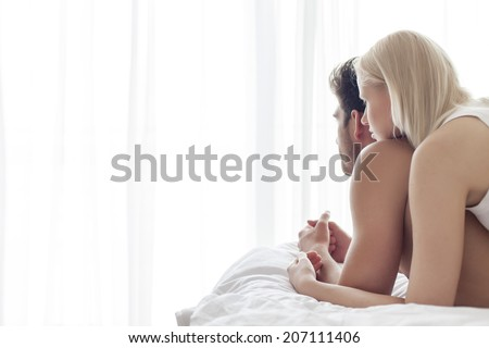 Young couple spending quality time in bed - stock photo
