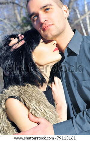 Young couple standing around in the nature - front view. - stock photo