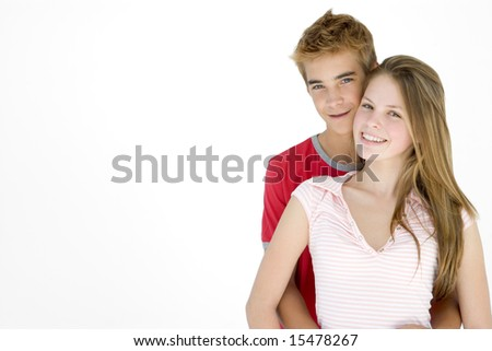 Young couple standing together smiling - stock photo