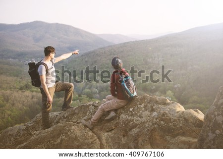 Young couple staring at the mountains. Toned Image.