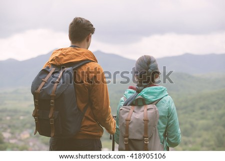 Young couple staring at the mountains. Toned Image. - stock photo