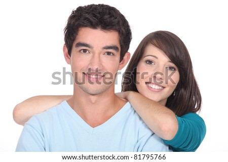 Young couple stood together against white background - stock photo