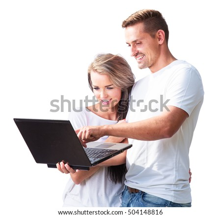 YOUNG COUPLE SURFING ON INTERNET AND  WORKING ON LAPTOP ISOLATED ON WHITE BACKGROUND
