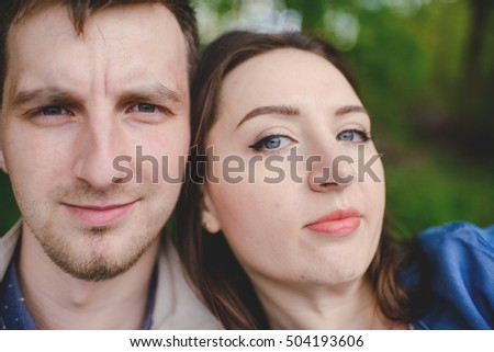 young couple taking a selfie on a summers day in the park