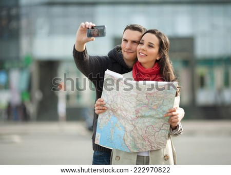Young couple taking a selfportrait with smartphone. People traveling - stock photo