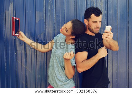 Young couple taking self photo with smartphone. Selfie, social networks, love, friendship, young adult, leisure concept. - stock photo