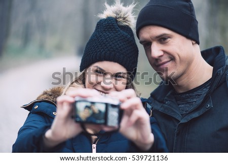 Young couple taking self portrait outdoor