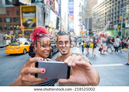Young Couple Taking Selfie in Times Square - stock photo