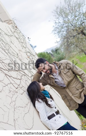 Young couple talking in a park - stock photo