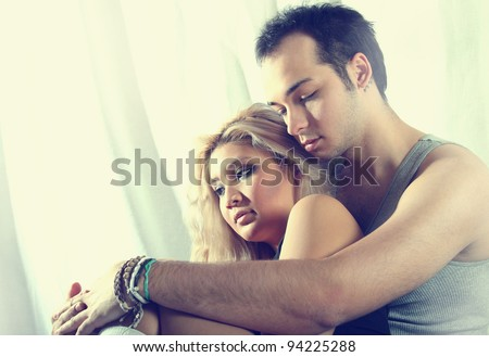 young couple thinking - stock photo
