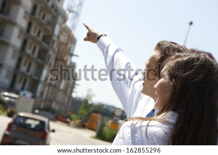 Young couple thinking and planing about dream house. - stock photo