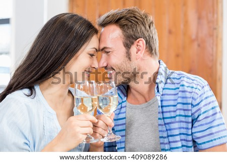 Young couple toasting wine glass at home - stock photo