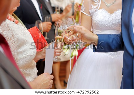 Young couple toasting with champagne at wedding reception