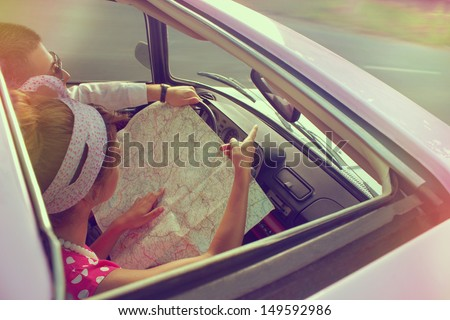 Young couple traveling by car on vacation - stock photo