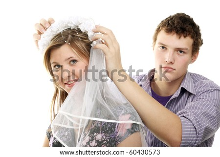 young couple trying on the wedding veil - stock photo