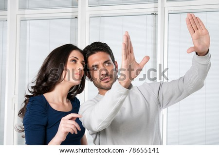 Young couple valuate and dreaming their new house - stock photo