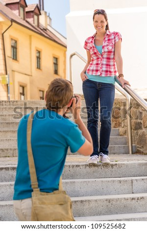 Young couple visit city take photos sightseeing tourist
