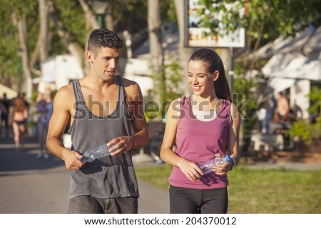 Young couple walking together, exercising outdoor  - stock photo