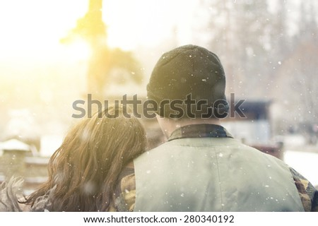 Young couple walking together in the winter park or forest. - stock photo
