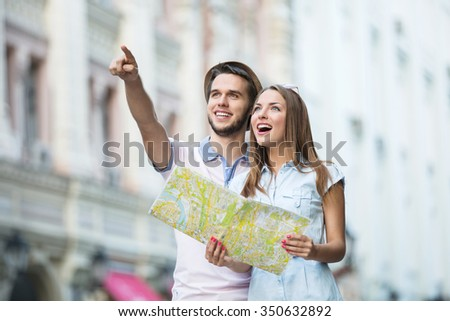 Young couple with a map on the street