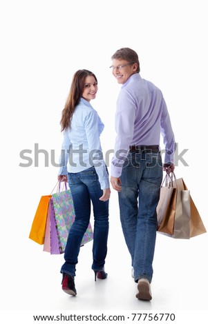 Young couple with a package on a white background - stock photo