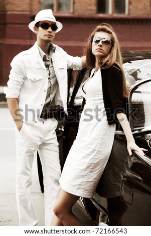 Young couple with a retro car - stock photo