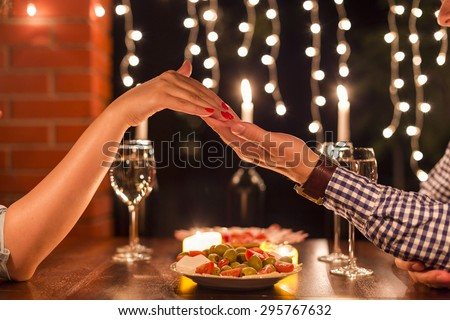Young couple with a romantic dinner with candles. Shallow Depth of field. Low lights. Night photos. - stock photo