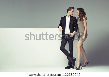 Young couple with big advert - stock photo