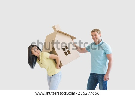 Young couple with cardboard house