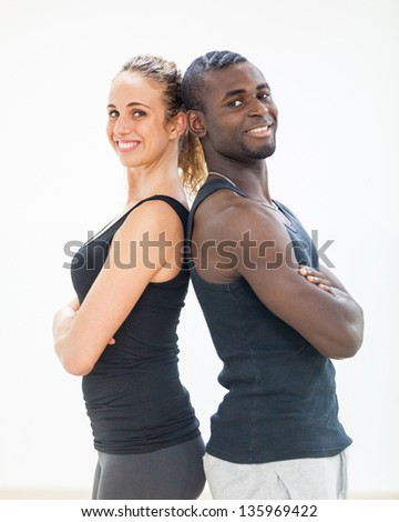 Young Couple with Gym Clothes - stock photo