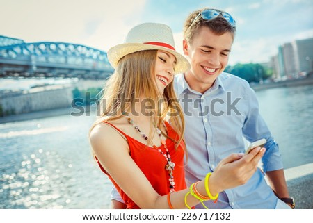 Young couple with mobile phone - stock photo