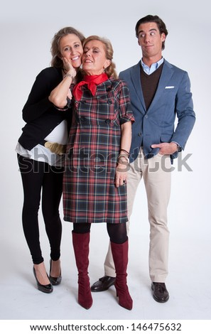 Young couple with mother in law - stock photo
