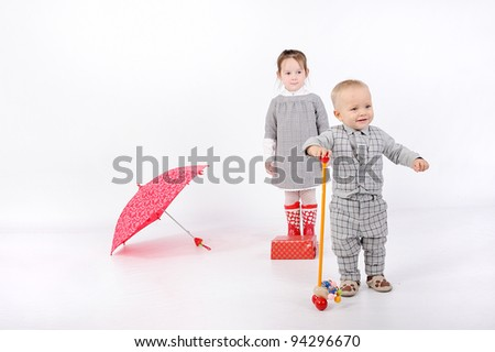 young couple with pink umbrella - stock photo