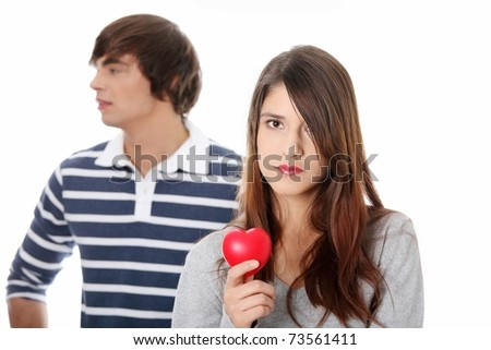 Young couple with red heart. Isolated on white background. - stock photo