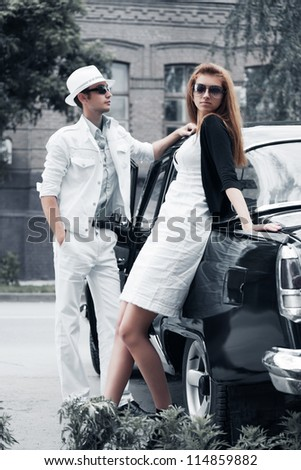 Young couple with retro car - stock photo