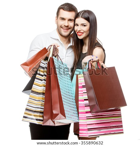 Young Couple with shopping bags isolated on white - stock photo
