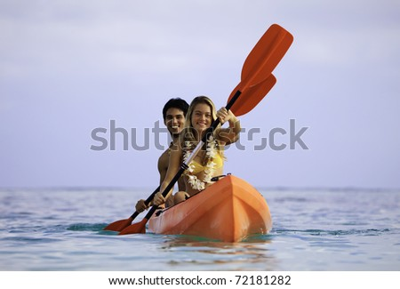 young couple with their kayak in hawaii - stock photo