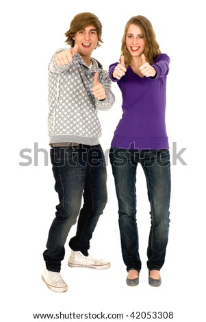 Young couple with thumbs up - stock photo