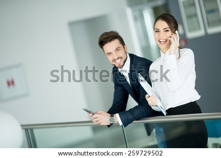 Young couple working in the office - stock photo