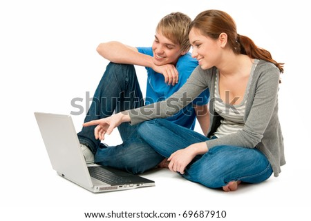 young couple working on laptop - stock photo