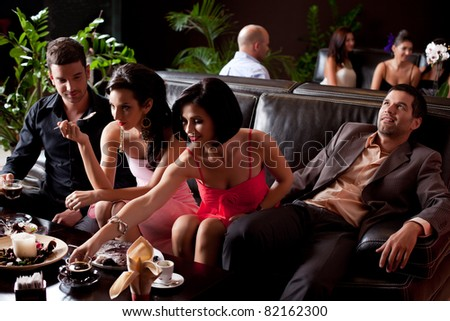 young couples eating deserts man borred