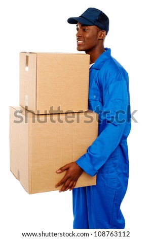 Young courier boy moving boxes looking away. Great services - stock photo