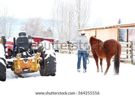 Young cowboy walking his horse back to its coral - stock photo