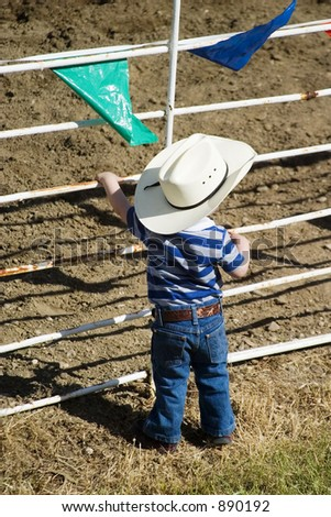 Young cowboy with big dreams - stock photo