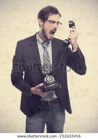 young crazy businessman shouting at phone