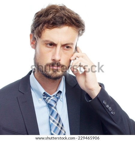 young crazy businessman speaking on phone