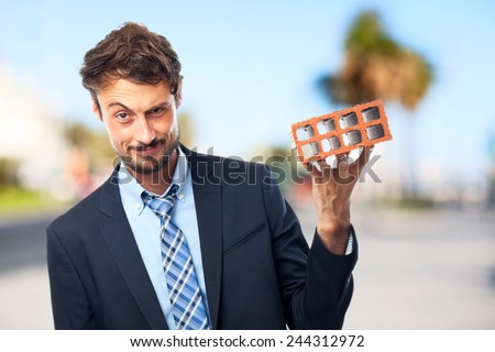 young crazy businessman with a brick
