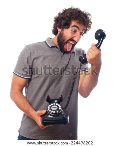 young crazy man shouting at phone - stock photo