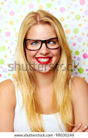 young crazy woman with eyeglasses in front of some dots - stock photo